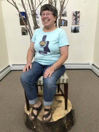 Nancy-Toney-on-the-Tree-Chair_Approved for Web_Peacham-Library_9.14.2018